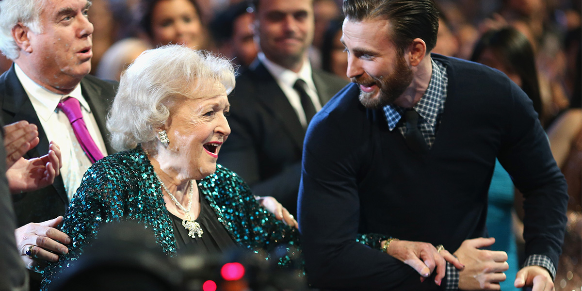 Chris Evans Helps Betty White to the Stage; America Swoons